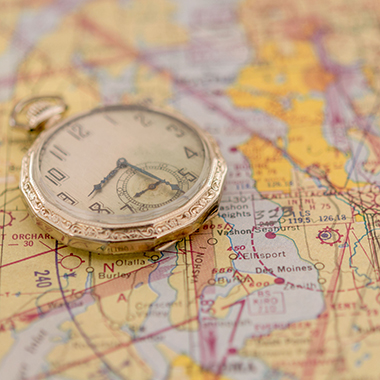 Pocket watch on air navigation chart