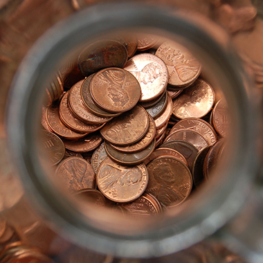 Pennies in glass jar from above