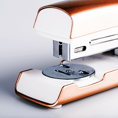 close up of stapler on white