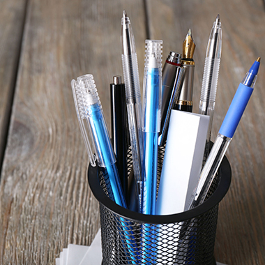 pens in metal holder