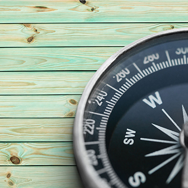 Compass on blue washed board