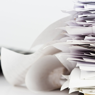 stack of receipts on business desk