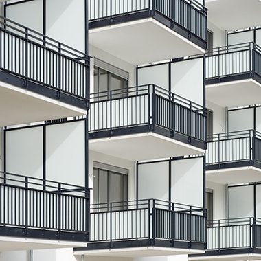 Exterior of white and black apartment balconies
