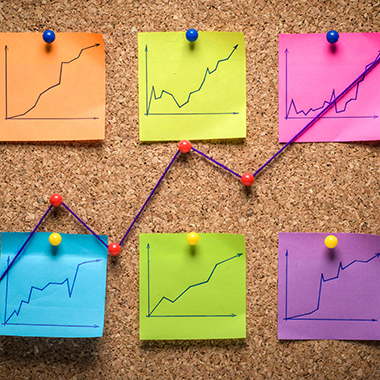 Sticky notes with line graphs