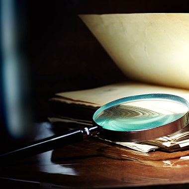 Open Book & Magnifying Glass